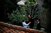 Seoul, South Korea<br /> June 1, 1987<br /> <br /> Kim Dea-jong (trimming tree) in his backyard under house arrest as opposition leader to the ruling party. <br /> <br /> <br /> Kim Dae-jung (3 December 1925 to 18 August 2009) was President of South Korea from 1998 to 2003, and the 2000 Nobel Peace Prize recipient. As of this date Kim is the first and only Nobel laureate to hail from Korea. A Roman Catholic since 1957, he has been called the &quot;Nelson Mandela of Asia&quot; for his long-standing opposition to authoritarian rule.