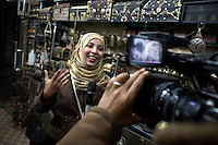 Mona, an anchorwoman for Aden TV makes a tourist program on Sana'a, in the old city.