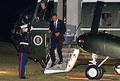 United States President Barack Obama arrives on the South Lawn of the White House in Washington, D.C. after returning from a series of events in Virginia and Texas in the early morning of March 10, 2012..Credit: Kristoffer Tripplaar  / Pool via CNP