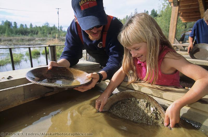 Young girl pans for gold, Fairbanks, Alaska