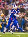 14 December 2014: Buffalo Bills quarterback Kyle Orton makes a handoff in the third quarter against the Green Bay Packers at Ralph Wilson Stadium in Orchard Park, NY. The Bills defeated the Packers 21-13, snapping the Packers' 5-game winning streak and keeping the Bills' 2014 playoff hopes alive. Mandatory Credit: Ed Wolfstein Photo *** RAW (NEF) Image File Available ***