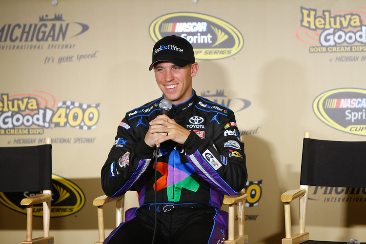 17 June, 2011: Denny Hamlin speaks during a press conference before the 43rd Annual Heluva Good! Sour Cream Dips 400 at Michigan International Speedway in Brooklyn, Michigan. (Photo by Jeff Speer :: SpeerPhoto.com)