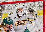 13 February 2015: University of Vermont Catamount Goaltender Madison Litchfield, a Sophomore from Williston, VT, makes a first period save against the University of New Hampshire Wildcats at Gutterson Fieldhouse in Burlington, Vermont. The Lady Catamounts fell to the visiting Wildcats 4-2 in the first game of their weekend Hockey East series. Mandatory Credit: Ed Wolfstein Photo *** RAW (NEF) Image File Available ***