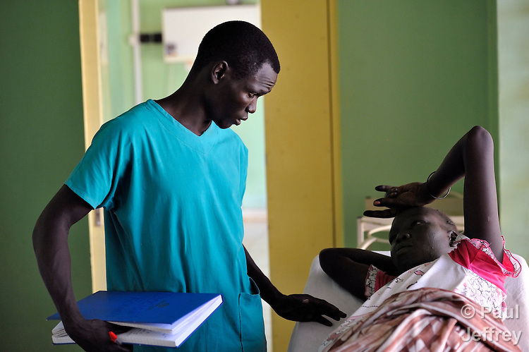 Kukani Tutu talks with a woman patient in the St. Daniel Comboni Catholic Hospital in Wau, South Sudan. Tutu is a student nurse from the Catholic Health Training Institute in Wau. Health care is minimal in the newly independent country, and many religious groups are providing personnel and training to fill the gap. The Institute is coordinated by Solidarity with South Sudan, an international consortium of more than 200 religious congregations that trains teachers, health workers and pastoral personnel in several locations throughout South Sudan..