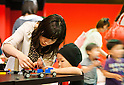 June 14, 2012, Tokyo, Japan - A Japanese mother and her son play with LEGO toys during a press preview event at the LEGOLAND Discovery Center Tokyo. The LEGOLAND Discovery Center contains over 3 million LEGO bricks in-house, a 4D movie theater, iconic city land marks of Tokyo all made of LEGO, and a interactive laser ride. The discovery center will open to the general public on June 15, 2012. (Photo by Christopher Jue/AFLO)