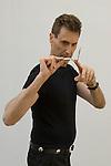 Uri Geller at home Berkshire England 2008. Bending spoon 1st image taken at 16. 37. 36 pm.