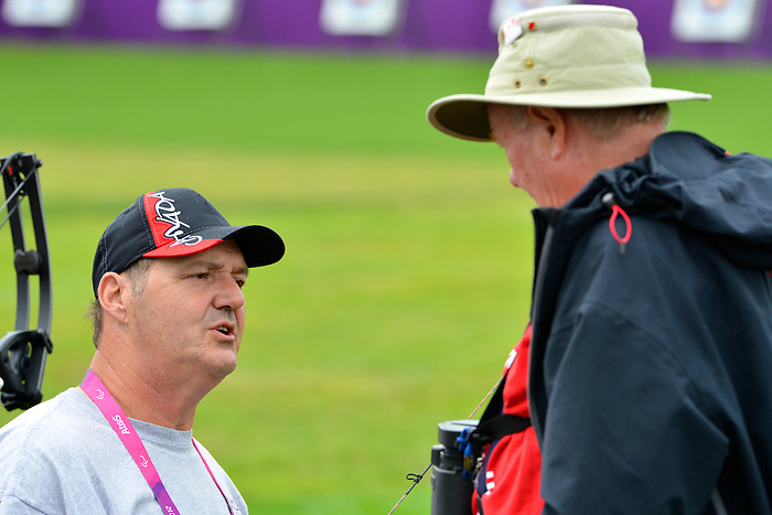 LONDON, ENGLAND 27/08/2012 - Norbert Murphy of the Canadian Paralympic Archery Team talks with his coach Vladimir Kopecky at a training session at the London 2012 Paralympic Games at The Royal Artillery Barracks. (Photo: Phillip MacCallum/Canadian Paralympic Committee)