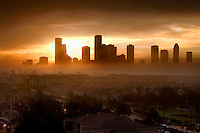 Stock photo of a foggy morning sunrise over Houston skyline