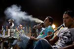 Young Iraqis enjoy an evening out in a restuarant hookah bar on the riverfront Abu Nuwass street of Baghdad, Iraq August 25, 2010. As security has improved and Iraqis begin to feel more comfortable venturing out again, scores of newly opened restaurants and cafes vie have sprouted up across the city.  .