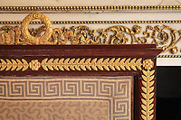 """Detail of fire screen, 1806, Jacob-Desmalter, mahogany and ormolu, in the background, the marble fire place with gilded carved stuccoes, Turkish Boudoir, redesigned in 1777 for Marie Antoinette, by architect Richard Mique, Chateau de Fontainebleau, France. The decoration is the achievement of the brothers Rousseau, and the furniture dates to the period of the First Empire, with precious textile work done by Jacob-Desmalter for Empress Josephine. Including a small bedroom, mirrors, and curtains raised by pulleys, this exceptional ensemble has been restored in 2014 thanks to the support of INSEAD and the generosity of subscribers of sponsors belonging to the group """"Des Mécènes pour Fontainebleau"""". Its opening to the public is schedule for Spring 2015. Picture by Manuel Cohen"""