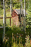 Wooden outhouse in the aspen trees in the ghost town of Crystal in the Elk Mountains of Colorado