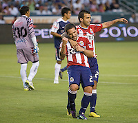 Chivas USA forward Giancarlo Maldonado (20) celebrates his first goal as goat with team mate midfielder Rodalfo Espinoza (24). USA Chivas USA defeated Pachuca FC 1-0 during 2010 SuperLiga group play at Home Depot Center stadium in Carson, California Wednesday July 21, 2010.