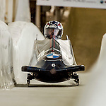 8 January 2016: Jamie Greubel Poser, piloting her 2-man bobsled for the United States of America, enters the Chicane straightaway on her first run, ending the day with a combined 2-run time of 1:53.48 and earning the gold medal at the BMW IBSF World Cup Championships at the Olympic Sports Track in Lake Placid, New York, USA. Mandatory Credit: Ed Wolfstein Photo *** RAW (NEF) Image File Available ***
