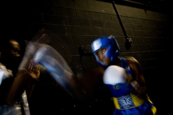 Matthew Williams, 17, of the Bronx, warms up before his fight.. Thursday was the first night of the finals of the  79th annual Golden Glove Boxing tournament. Boxers from all over the New York who made it through the previous rounds were on hand at Madison Square Garden to compete for the coveted Golden Gloves Champion title.