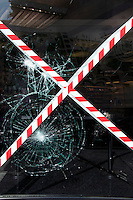 The damaged window of a shop in the London borough of Hackney. London saw the beginnings of riots on Saturday evening, after a peaceful protest in response to the shooting by police of Mark Duggan during an attempted arrest, escalated into violence. By the third night of violence, rioting had spread to many areas of the capital and to other cities around the country.