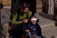 Roma 20 Marzo 2015<br /> Eclissi solare parziale al quartiere San Lorenzo. La gente si riunita questa mattina in Piazza Immacolata, per osservare  l'eclissi solare parziale. Un bambino con gli occhiali da sole speciali di protezione, rimane meravigliato vedendo l'eclissi di sole.<br /> <br /> Rome March 20, 2015<br /> Partial solar eclipse. People gather this morning in Piazza Immacolata, District San Lorenzo, to get a rare glimpse of the solar eclipse. A child with  special protective sunglasses, marveled seeing solar eclipse.