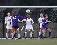 "University of Washington midfielder Kate Deines (2) direct kick into Boston College wall. In overtime, Boston College defeated University of Washington, 1-0, in NCAA tournament ""Elite 8"" match at Newton Soccer Field, Newton, MA, on November 27, 2010."