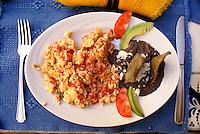 Huevos a la Mexicana and black beans, restaurant of  the Posada de las Minas, a luxury boutique hotel in Mineral de Pozos, Guanajuato, Mexico
