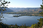 A view of lower Lake Chelan from Bear Mountain with Wapato Point in the foreground and the orchard community of Manson.