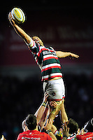 Ed Slater of Leicester Tigers reaches out to win the ball at a lineout. Aviva Premiership match, between Leicester Tigers and Saracens on January 1, 2017 at Welford Road in Leicester, England. Photo by: Patrick Khachfe / JMP