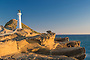 Rocky cliffs and Castlepoint lighthouse, Wairarapa