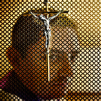 36 year old Father Alfonso Corona behind a crucifix in his confessional. He was a close friend of the late founder of the Legionaries of Christ Marcial Maciel and was with him until he died following many controversies and scandals. The Legion of Christ is a conservative Roman Catholic congregation whose members take vows of chastity, obedience and poverty.