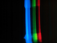 SPECTRUM ANALYSIS: EMISSION (BRIGHT LINE) SPECTRA<br /> Iodine (I)<br /> Electrical discharge passes through the spectrum tube, which is filled with gas, causing electrons in the gas to be excited.  As the electrons relax, they emit light - a characteristic color for each gas.
