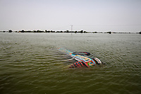 A submerged bus lies in flood water near the town of Dadu, in Sindh province, Pakistan.