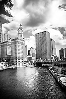 Photo of Chicago downtown at Michigan Avenue Bridge (DuSable Bridge) with the Wrigley Building and The Equitable building along the Chicago River.