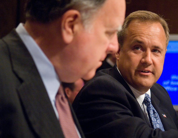 OMB Director nominee Jim Nussle, right, speaks with House Budget Committee chairman John Spratt, D-S.C., before the start of the Senate Budget Committee confirmation hearing on Nussle's nomination on Thursday, July 26, 2007.