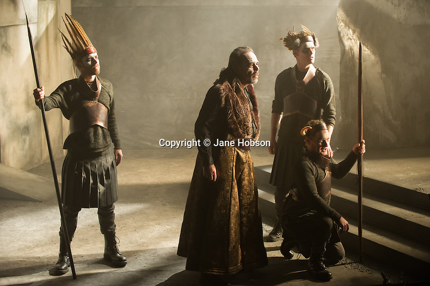 London, UK. 11.02.2014. English Touring Opera presents KING PRIAM in the Linbury Studio at the Royal Opera House. Picture shows:   Johnny Herford (Hunter 2), Roderick Earle (Priam), Henry Manning (Hunter 3) and Stuart Haycock (Hunter 1). Photograph © Jane Hobson.