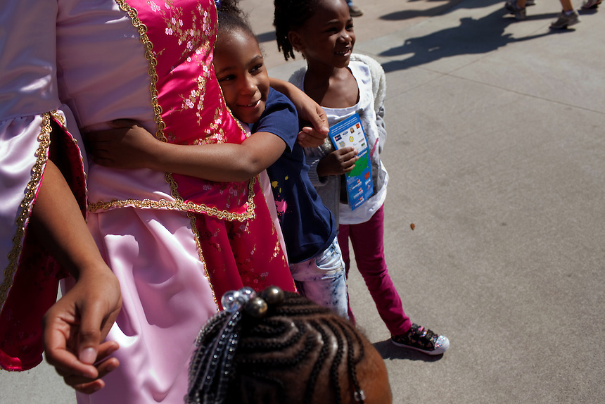 "Iesha Ortiz as ""Princess Lily,"" hugs Mya Paben, Addison Chamberlain with Alyssa Durrett (head foreground) in Duplo Village in Legoland in Whitehaven, Florida on February 11, 2012."