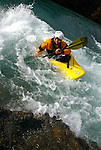 Kayaker in yellow kayak and orange jacket.  Idaho. Model released.