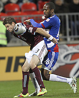 Atiba Harris#16 of FC Dallas pushes into the back of Drew Moor#3 of the Colorado Rapids during MLS Cup 2010 at BMO Stadium in Toronto, Ontario on November 21 2010.Colorado won 2-1 in overtime.