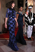 First lady Michelle Obama (2nd L) and Samantha Cameron (L), wife of British Prime Minister David Cameron, leave after they posed for an official photo at the Grand Staircase of the White House March 14, 2012 in Washington, DC. Prime Minister Cameron was on a three-day visit in the U.S. and he had talks with President Obama earlier the day.  .Credit: Alex Wong / Pool via CNP