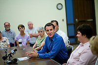 Republican presidential hopeful Tim Pawlenty, center, campaigns on Tuesday, July 26, 2011 in Washington, IA.
