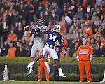 Ole Miss' Donte Moncrief (12) has the ball batted away by Auburn's Erique Florence (14) at Jordan-Hare Stadium in Auburn, Ala. on Saturday, October 29, 2011. .