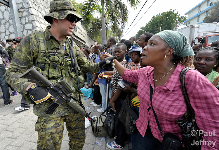 Canadian embassy in port au prince attracts crowd of hopeful quake survivors kairosphotos - Port au prince radio station ...