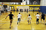 Tufts University Medical and Dental Students play dodgeball at the Chinatown YMCA. (Matt Modoono for Tufts University)