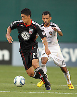 Pablo Hernandez #21 of D.C. United breaks away from Juninho #19 of the Los Angeles Galaxy during an MLS match at RFK Stadium on July 18 2010, in Washington D.C. Galaxy won 2-1.