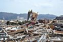 April 2nd, 2011, Ofunato, Japan - A broken house is upended amid the debris in Ofunato City, Iwate Prefecture, on April 2, 2011, three weeks after this northeastern Japanese fishing port nestled deep inside an inlet was destroyed by a magnitude 9.0 earthquake and ensuing tsunami. (Photo by Natsuki Sakai/AFLO) [3615] -mis-...