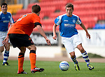 St Johnstone v Dundee United....07.08.12  SPL Under 20 League.Scott Gray is closed down by Ross Gilmour.Picture by Graeme Hart..Copyright Perthshire Picture Agency.Tel: 01738 623350  Mobile: 07990 594431