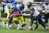 Newark, DE - October 29, 2016: Delaware Fightin Blue Hens running back Thomas Jefferson (28) is tackled by several Towson Tigers defenders during game between Towson and Delware at  Delaware Stadium in Newark, DE.  (Photo by Elliott Brown/Media Images International)