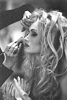 Photo of an Actress & Model getting Her Make-up done. This is a Very grainy Black & White 35mm film scan.