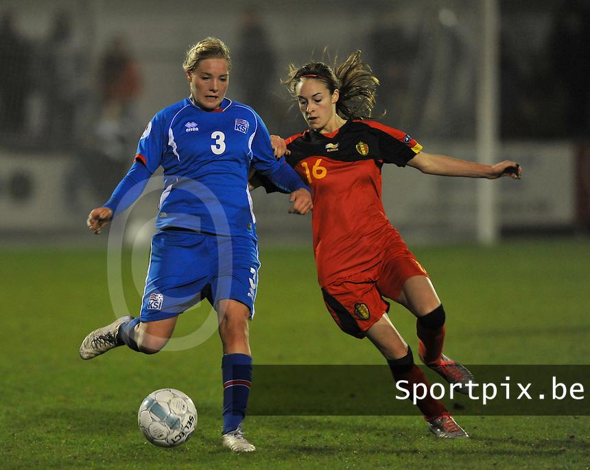 Qualification Women's Euro 2013 - Belgium - Iceland ; Belgie - Ijsland ; Armand Melis Stadion Dessel :.Rakel Honnudottir aan de bal voor Tessa Wullaert.foto DAVID CATRY / Vrouwenteam.be