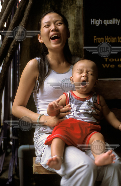 Young mother with her son.