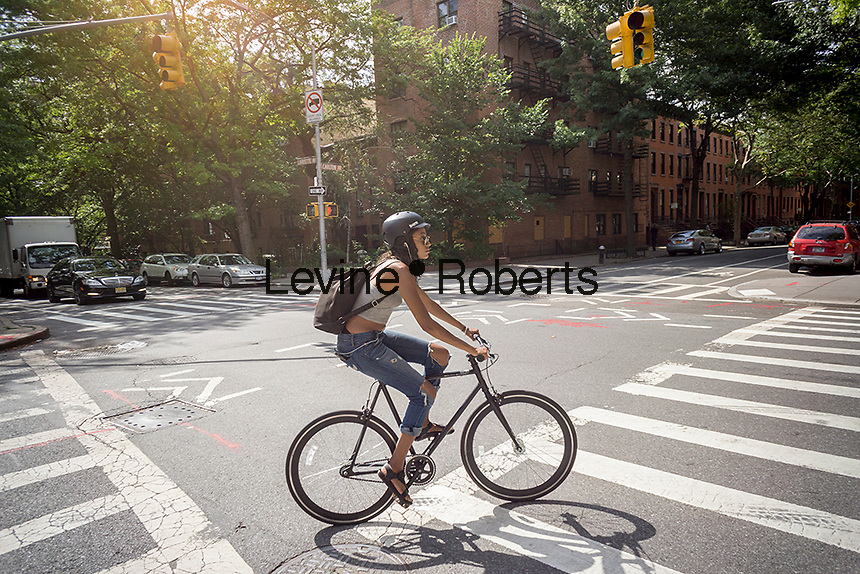 A bicyclist in the Fort Greene neighborhood of Brooklyn in New York on Saturday, June 2, 2016. (©Richard B. Levine)