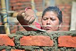 Bhagwati Tamang lays bricks in Jogimara, a village in the Dhading District of Nepal where Dan Church Aid, a member of the ACT Alliance, has provided a variety of support to local villagers in the wake of a devastating 2015 earthquake. Tamang, an experienced mason, has helped the ACT Alliance train other carpenters and masons in the community so they'll be ready to help construct permanent housing once the Nepali government begins to disburse funds.