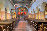 Chapel Sanctuary with alter, pews, tile floor, adobe building at Mission San Juan Batista, a historic Spanish mission on the &quot;Mission Trail&quot; in the city of San Juan Batista, California.  Founded  1797.