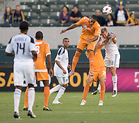 Puerto Islanders Nicholas Addlery (11) battles with LA Galaxy defender Gregg Berhalter (16). The Puerto Rico Islanders defeated the LA Galaxy 4-1 during CONCACAF Champions League group play at Home Depot Center stadium in Carson, California on Tuesday July 27, 2010.